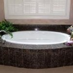 Tropical forest brown marble versus granite bath